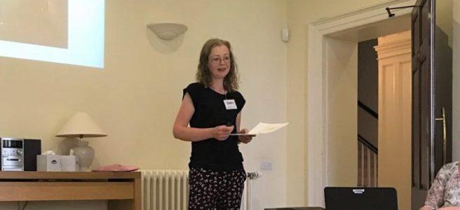 Joan giving a presentation