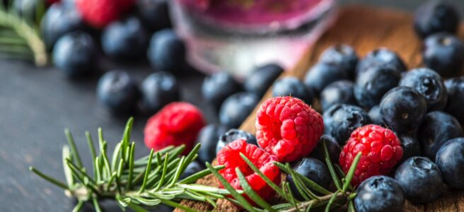 raspberries, blueberries and rosemary